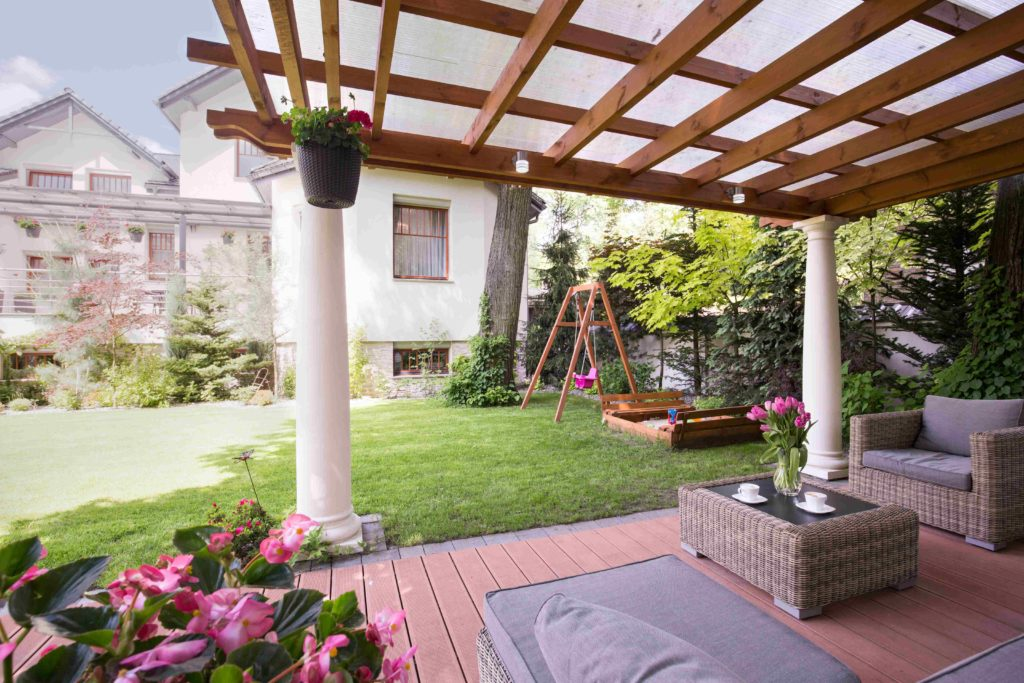 Backyard with gorgeous view of cleaned house and windows.